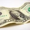 Cum a ajuns dolarul sperietoarea economiei româneşti