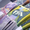 Ministrul Finanţelor: Deprecierea leului aduce mai mulţi bani la bugetul de stat